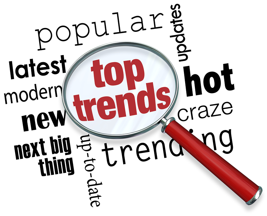 Top Trends words under a magnifying glass to illustrate the late
